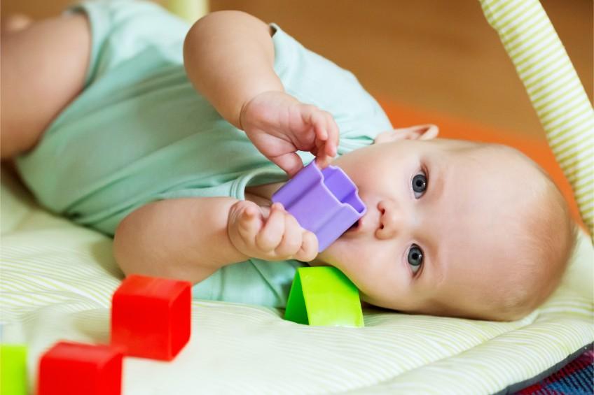 Baby on play mat - Family Start